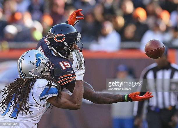 Brandon Marshall of the Chicago Bears misses a catch under pressure from Rashean Mathis of the Detroit Lions at Soldier Field on November 10 2013 in...