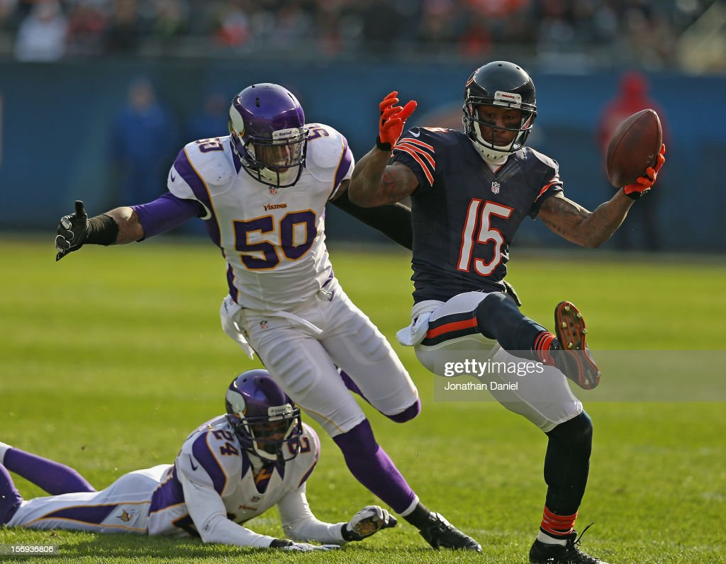 Brandon Marshall #15 of the Chicago Bears runs after a catch as Erin Henderson #50 and A.J. Jefferson #24 of the Minnesota Vikings pursue at Soldier Field on November 25, 2012 in Chicago, Illinois.
