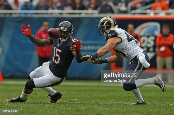 Brandon Marshall of the Chicago Bears tries to catch a pass as Craig Dahl of the St Louis Rams closes in at Soldier Field on September 23 2012 in...