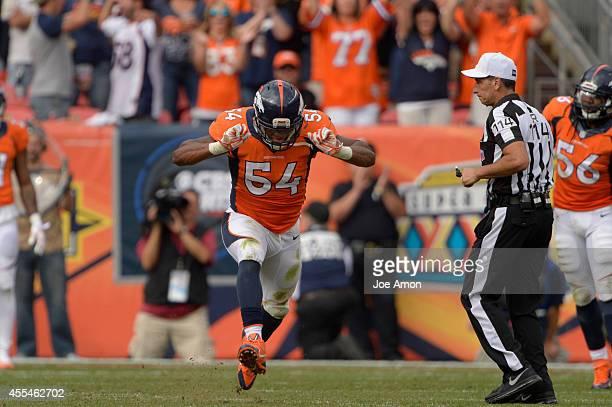 Brandon Marshall of the Denver Broncos celebrates after a sack in the fourth quarter The Denver Broncos played the Kansas City Chiefs at Sports...