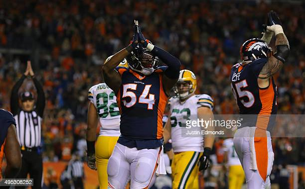 Brandon Marshall of the Denver Broncos celebrates the saftey in the fourth quarter against the Green Bay Packers at Sports Authority Field at Mile...