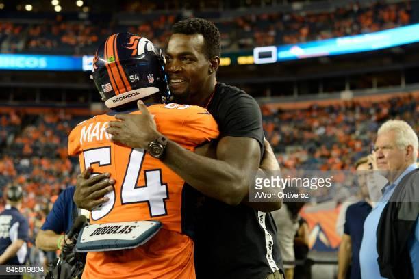 Brandon Marshall of the Denver Broncos hugs Denver Nuggets free agent acquisition Paul Millsap before the first quarter on Monday September 11 2017...