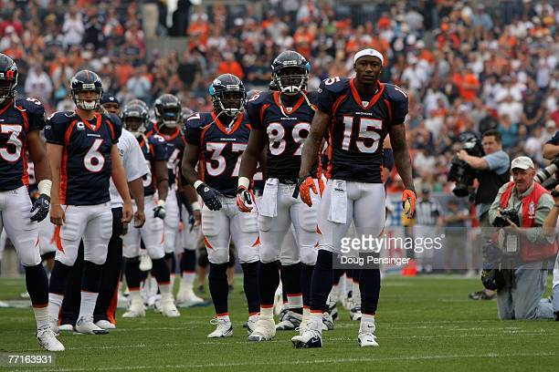 Brandon Marshall of the Denver Broncos stands on the field with teammates before the game against the Jacksonville Jaguars at Invesco Field at Mile...