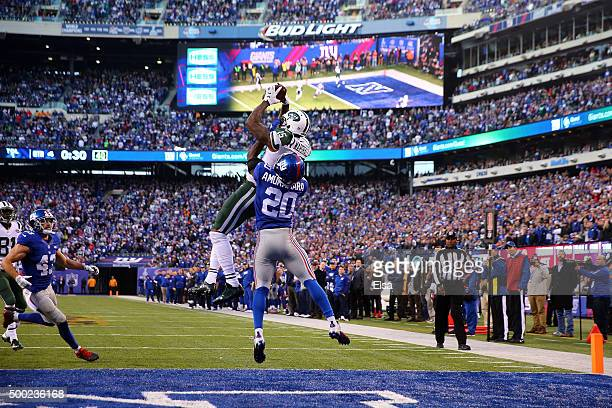 Brandon Marshall of the New York Jets catches a touchdown late in the game against Prince Amukamara of the New York Giants at MetLife Stadium on...