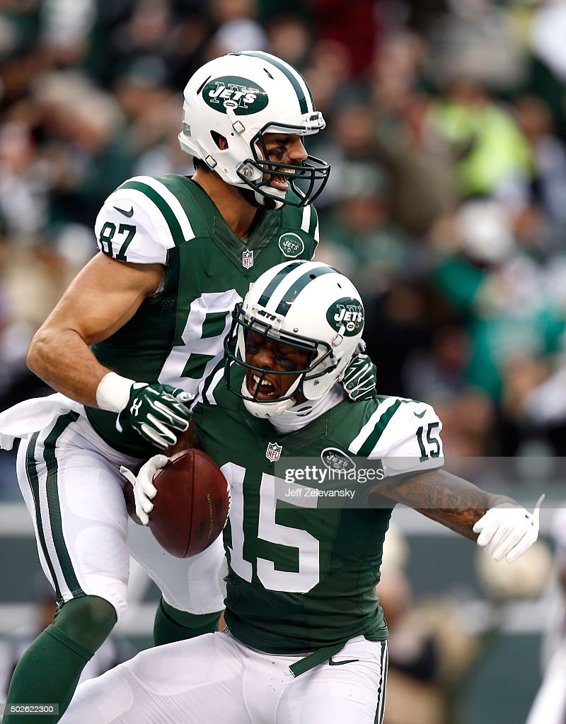 Brandon Marshall of the New York Jets celebrates with his teammate Eric Decker after scoring a 33 yard touchdown in the third quarter against the New...