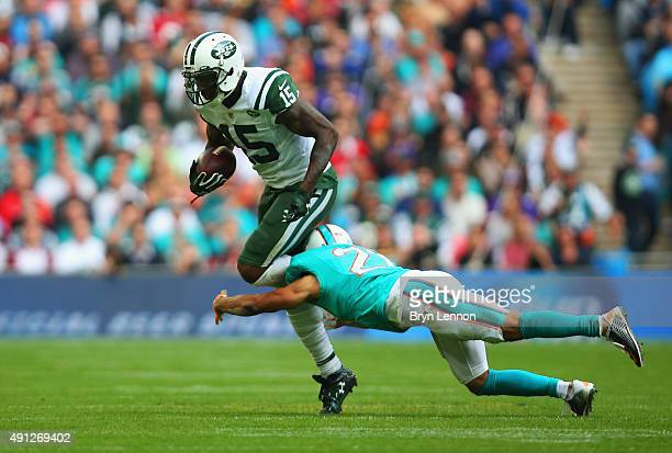 Brandon Marshall of the New York Jets is tackled by Brent Grimes of the Miami Dolphins during the game at Wembley Stadium on October 4 2015 in London...