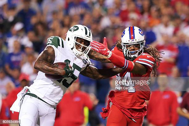Brandon Marshall of the New York Jets is tackled by Stephon Gilmore of the Buffalo Bills resulting in putting Marshall out for the game during the...