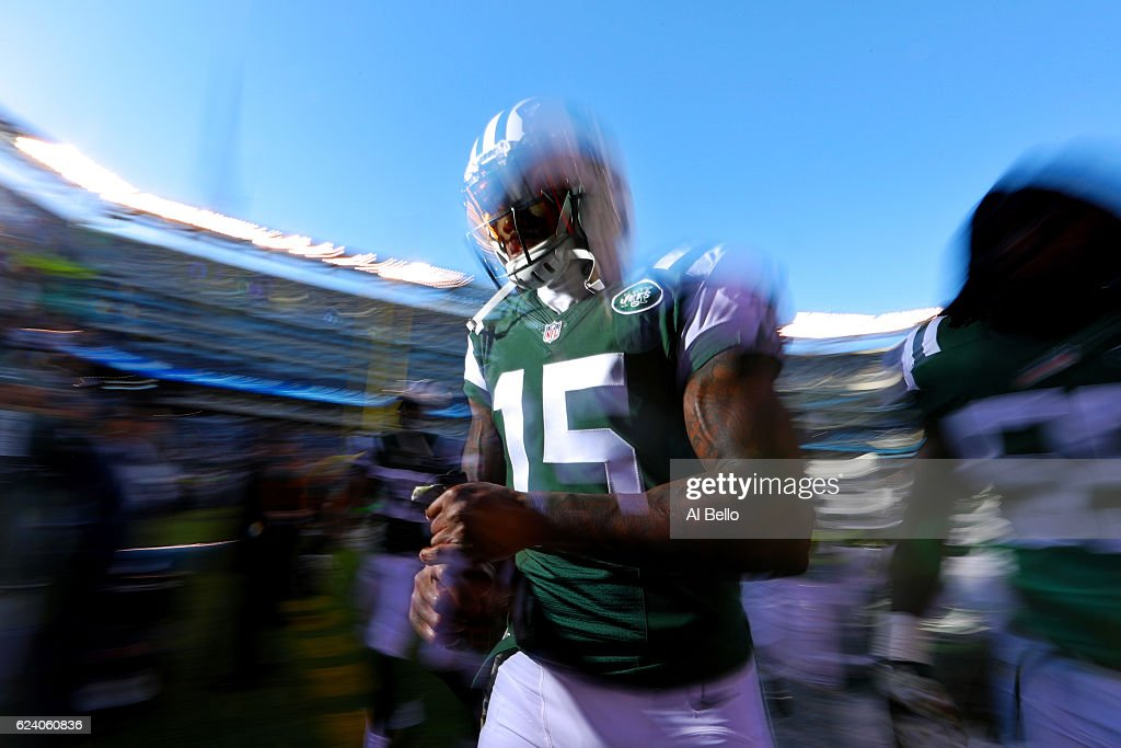 Brandon Marshall #15 of the New York Jets runs off the field after warm ups before playing against the Los Angeles Rams at MetLife Stadium on November 13, 2016 in East Rutherford, New Jersey.