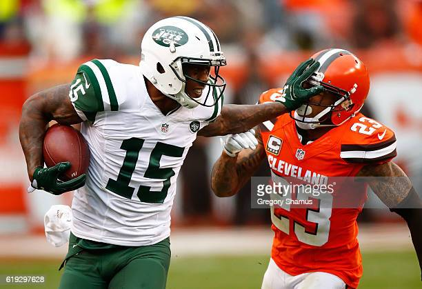Brandon Marshall of the New York Jets stiff arms Joe Haden of the Cleveland Browns during the fourth quarter at FirstEnergy Stadium on October 30...