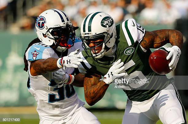 Brandon Marshall of the New York Jets tries to avoid the tackle of BW Webb of the Tennessee Titans in the first quarter during their game at MetLife...