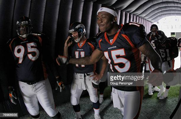 Brandon Marshall Patrick Ramsey and Sam Adams of the Denver Broncos prepare for intoductions against the Jacksonville Jaguars during week three NFL...