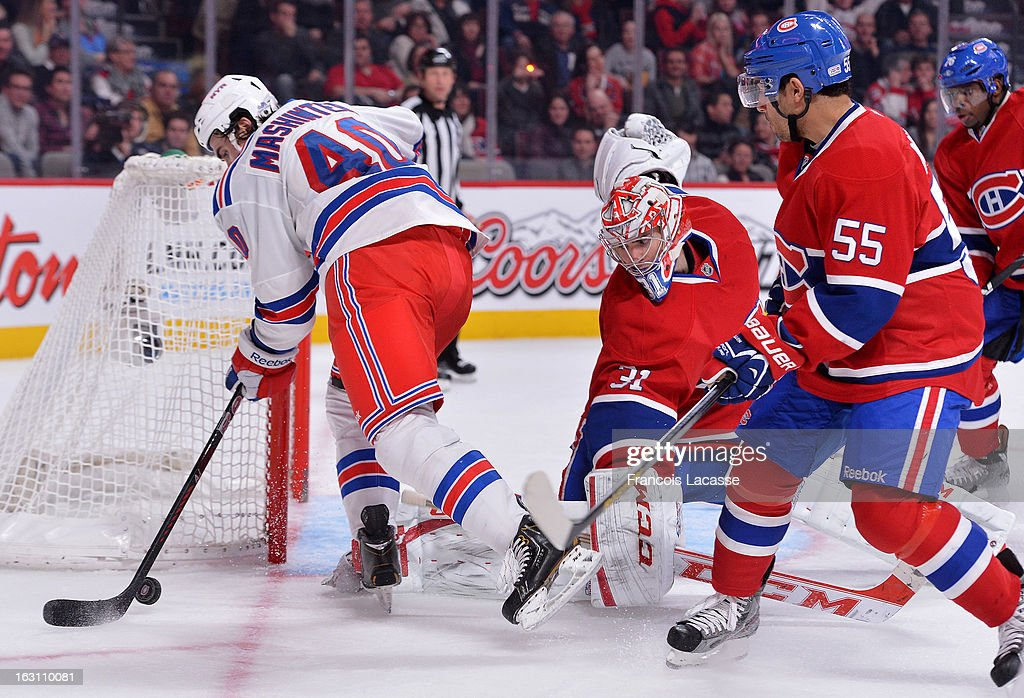 Brandon Mashinter #40 of the New York Rangers digs for a rebound after a save by Carey Price #31 of the Montreal Canadiens during the NHL game on February 23, 2013 at the Bell Centre in Montreal, Quebec, Canada.