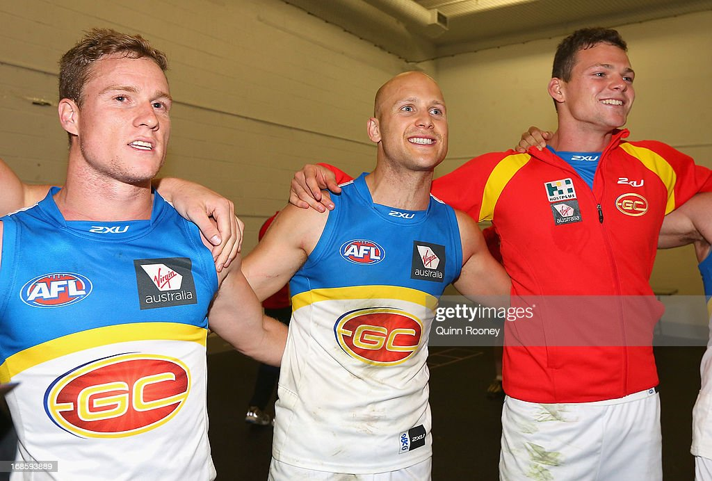 Brandon Matera, Gary Ablett and Steven May of the Suns sing the song in the rooms after winning the round seven AFL match between the Melbourne Demons and the Gold Coast Suns at Melbourne Cricket Ground on May 12, 2013 in Melbourne, Australia.