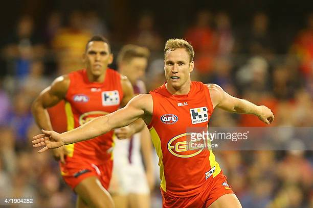Brandon Matera of the Sun celebrates a goal during the round five AFL match between the Gold Coast Suns and the Brisbane Lions at Metricon Stadium on...