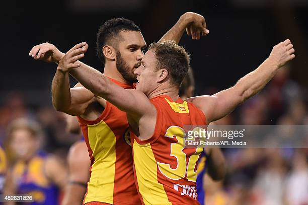 Brandon Matera of the Suns celebrates kicking a goal with Harley Bennell during the round 18 AFL match between the Gold Coast Suns and the West Coast...