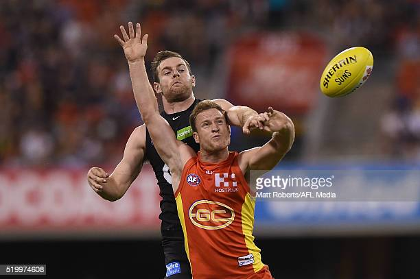 Brandon Matera of the Suns competes for the ball against Sam Docherty of the Blues during the round three AFL match between the Gold Coast Suns and...