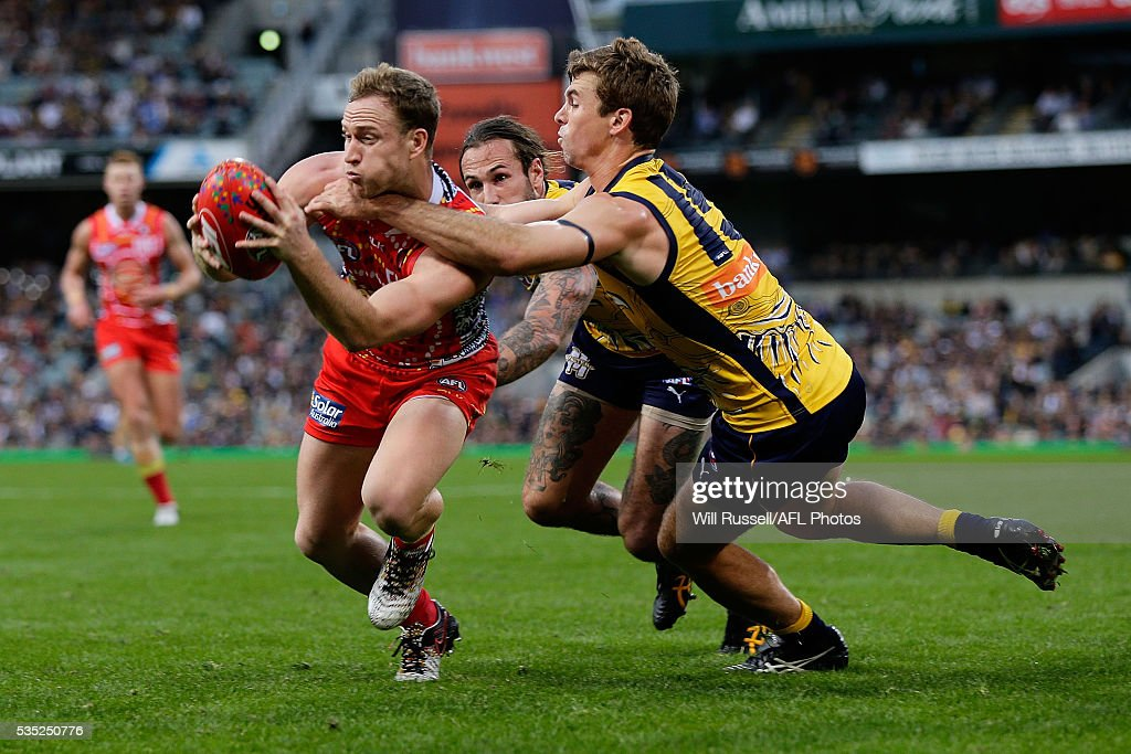 Brandon Matera of the Suns is tackled by Jamie Cripps of the Eagles during the round 10 AFL match between the West Coast Eagles and the Gold Coast Suns at Domain Stadium on May 29, 2016 in Perth, Australia.