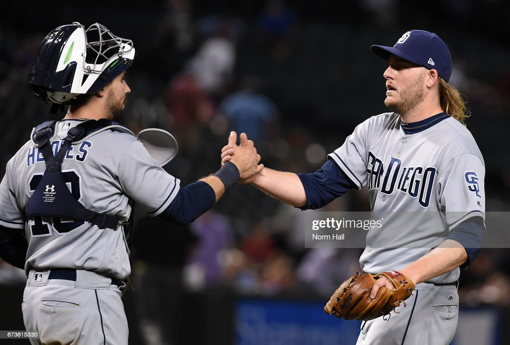 Brandon Maurer #37 of the San Diego Padres and teammate Austin Hedges #18 shake hands after an 8-5 win against the Arizona Diamondbacks at Chase Field on April 26, 2017 in Phoenix, Arizona.