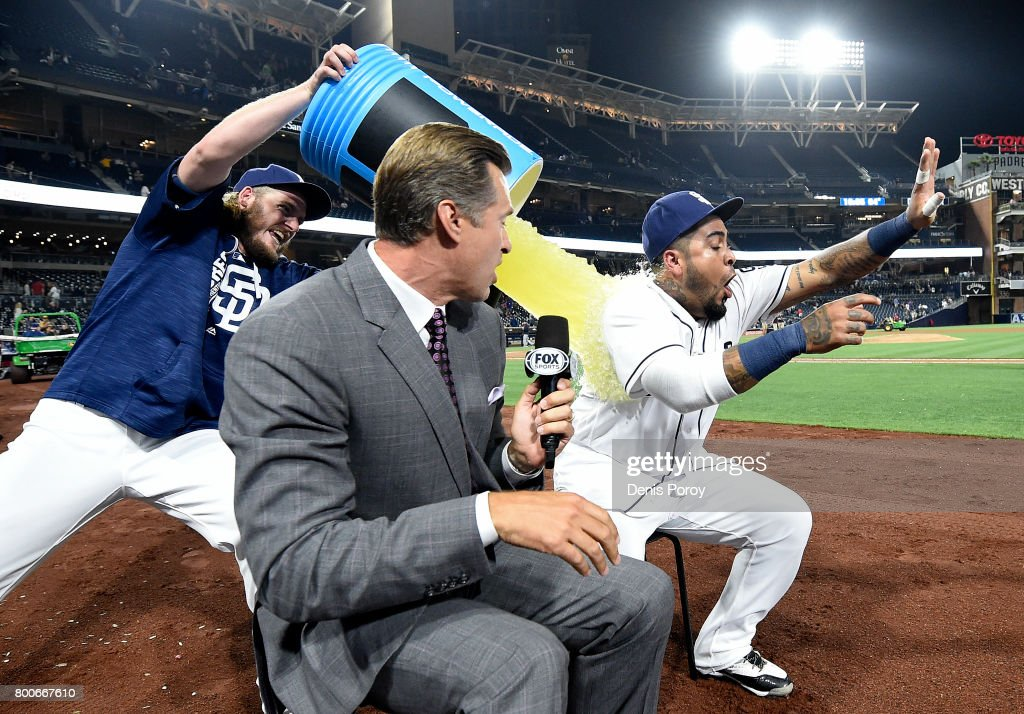 Brandon Maurer #37 of the San Diego Padres dumps Gatorade on Hector Sanchez #44 as announcer Bob Scanlan looks on after a baseball game against the Detroit Tigers at PETCO Park on June 24, 2017 in San Diego, California. The Padres won 7-3.