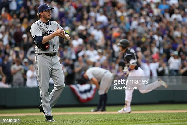 Brandon Maurer of the San Diego Padres returns to the mound as Trevor Story of the Colorado Rockies rounds the bases on his solo home run to take a...