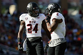Brandon Mayes of the Northern Illinois Huskies talks with Marlon Moore during the second half against the Boston College Eagles at Alumni Stadium on...