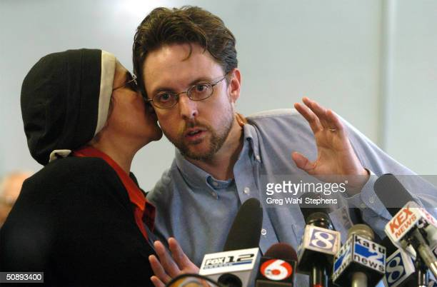 Brandon Mayfield listens to comments from his wife Mona during a press conference May 24 2004 in Portland Oregon Mayfield was exonerated of...
