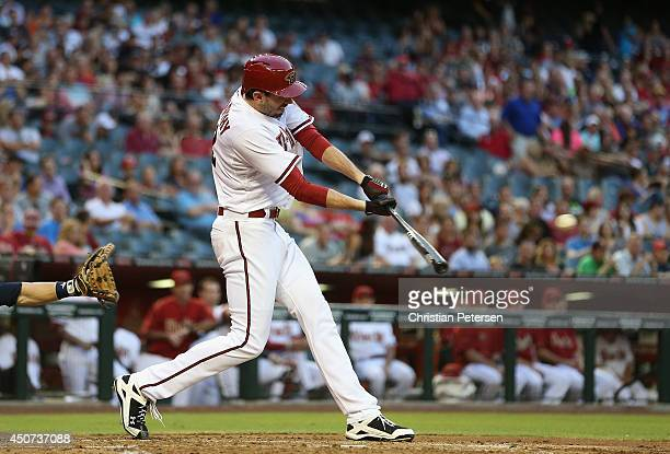 Brandon McCarthy of the Arizona Diamondbacks hits a two RBI single against the Milwaukee Brewers during the second inning of the MLB game at Chase...