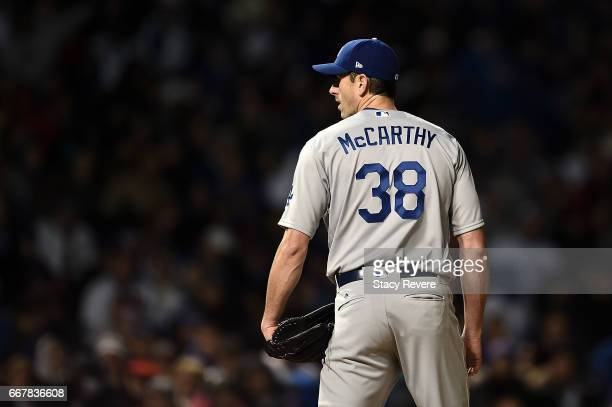 Brandon McCarthy of the Los Angeles Dodgers prepares to throw a pitch during the third inning of a game against the Chicago Cubs at Wrigley Field on...