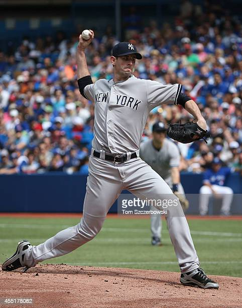 Brandon McCarthy of the New York Yankees delivers a pitch during MLB game action against the Toronto Blue Jays on August 31 2014 at Rogers Centre in...