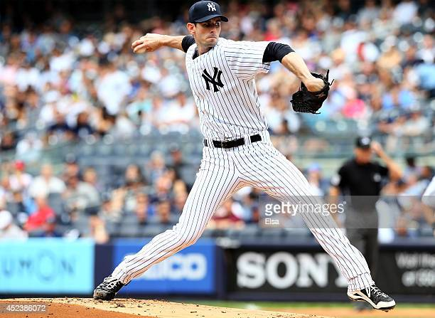 Brandon McCarthy of the New York Yankees delivers a pitch in the first inning against the Cincinnati Reds on July 19 2014 at Yankee Stadium in the...