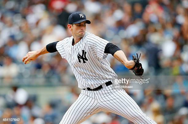 Brandon McCarthy of the New York Yankees in action against the Houston Astros at Yankee Stadium on August 21 2014 in the Bronx borough of New York...