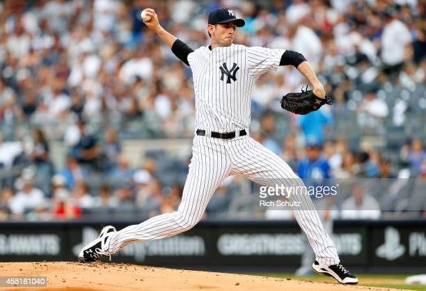 Brandon McCarthy of the New York Yankees in action against the Kansas City Royals during the first inning of a MLB baseball game at Yankee Stadium on...