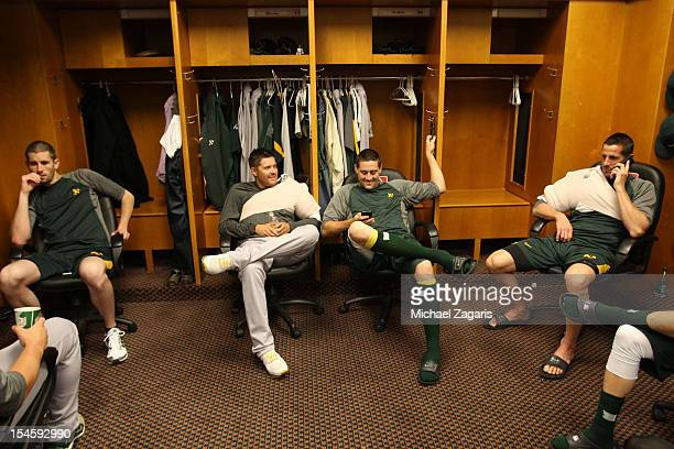 Brandon McCarthy Travis Blackley Pat Neshek and Grant Balfour of the Oakland Athletics relax in the clubhouse prior to the game against the Detroit...