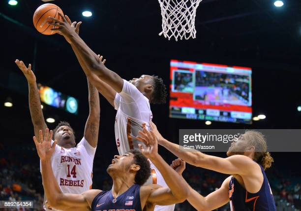 Brandon McCoy and Tervell Beck of the UNLV Rebels battle for a rebound against Mark Smith and Michael Finke of the Illinois Fighting Illini during...