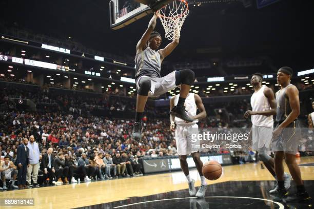 Brandon McCoy dunks during the Jordan Brand Classic National Boys Team AllStar basketball game at The Barclays Center on April 14 2017 in New York...
