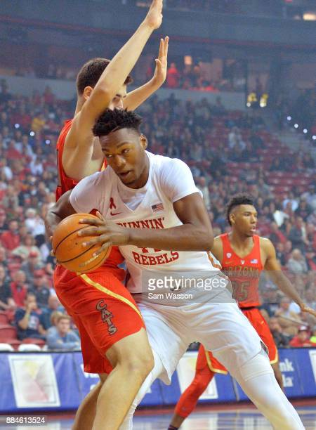 Brandon McCoy of the UNLV Rebels drives against Dusan Ristic of the Arizona Wildcats during their game at the Thomas Mack Center on December 2 2017...
