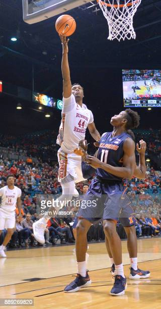 Brandon McCoy of the UNLV Rebels drives in for a layup against Greg Eboigbodin of the Illinois Fighting Illini during their game at the MGM Grand...