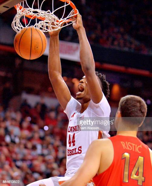 Brandon McCoy of the UNLV Rebels dunks against Dusan Ristic of the Arizona Wildcats during their game at the Thomas Mack Center on December 2 2017 in...