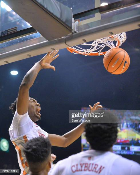 Brandon McCoy of the UNLV Rebels dunks against the Illinois Fighting Illini as Kris Clyburn of the UNLV Rebels looks on during their game at the MGM...