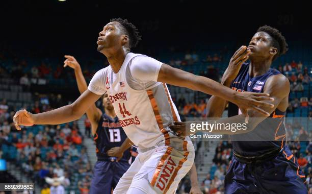 Brandon McCoy of the UNLV Rebels gets in position for a rebound against Greg Eboigbodin of the Illinois Fighting Illini during their game at the MGM...