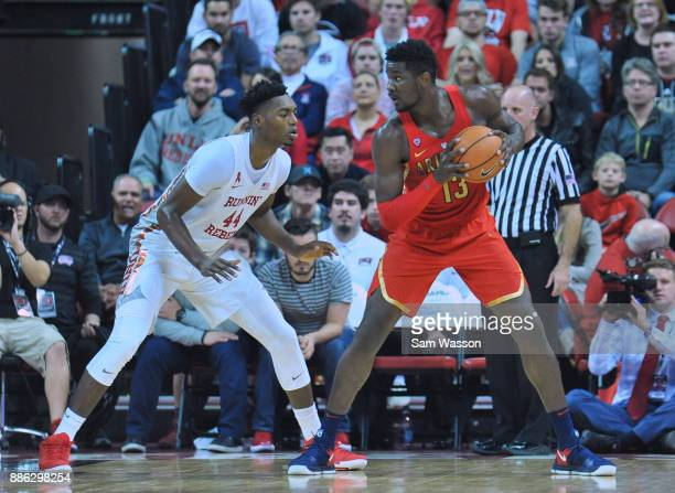 Brandon McCoy of the UNLV Rebels guards Deandre Ayton of the Arizona Wildcats during their game at the Thomas Mack Center on December 2 2017 in Las...
