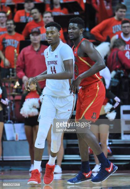 Brandon McCoy of the UNLV Rebels is guarded by Deandre Ayton of the Arizona Wildcats during their game at the Thomas Mack Center on December 2 2017...