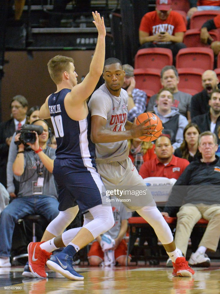 Brandon McCoy #44 of the UNLV Rebels posts up against Quinn Taylor #10 of the Utah State Aggies during their game at the Thomas & Mack Center on January 6, 2018 in Las Vegas, Nevada. Utah State won 85-78.