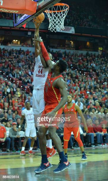 Brandon McCoy of the UNLV Rebels shoots a layup against Deandre Ayton of the Arizona Wildcats during their game at the Thomas Mack Center on December...