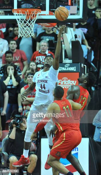 Brandon McCoy of the UNLV Rebels shoots a layup against Deandre Ayton of the Arizona Wildcats as Ira Lee of the Arizona Wildcats looks on during...