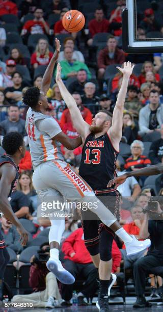 Brandon McCoy of the UNLV Rebels shoots against David Collette of the Utah Utes during the championship game of the Main Event basketball tournament...