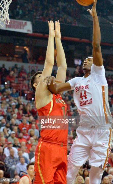 Brandon McCoy of the UNLV Rebels shoots against Dusan Ristic of the Arizona Wildcats during their game at the Thomas Mack Center on December 2 2017...