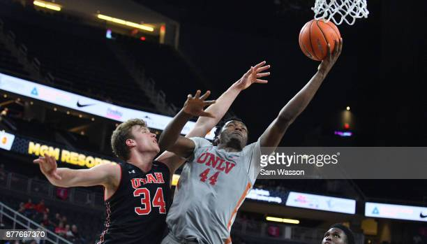 Brandon McCoy of the UNLV Rebels shoots against Jayce Johnson of the Utah Utes during the championship game of the Main Event basketball tournament...