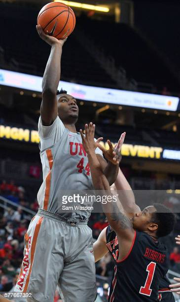 Brandon McCoy of the UNLV Rebels shoots against Justin Bibbins of the Utah Utes during the championship game of the Main Event basketball tournament...
