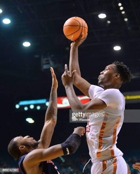 Brandon McCoy of the UNLV Rebels shoots against Leron Black of the Illinois Fighting Illini during their game at the MGM Grand Garden Arena on...